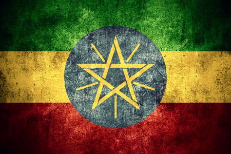 ethiopian: flag of Ethiopia or Ethiopian banner on rough pattern texture vintage background Stock Photo