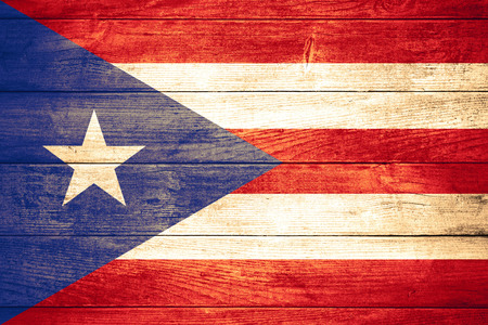 puerto rican: flag of  Puerto Rico or Puerto Rican  banner on wooden background