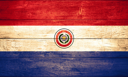 paraguay: flag of Paraguay or Paraguayan banner on wooden background Stock Photo