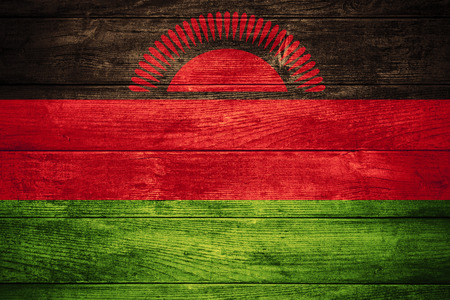 malawian flag: flag of Malawi or Malawian banner on wooden background
