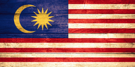 malaysia culture: flag of Malaysia or Malaysian banner on wooden background