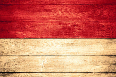 flag of Indonesia or Indonesian banner on wooden background
