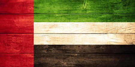 united arab emirates: flag of the United Arab Emirates or  banner on wooden background