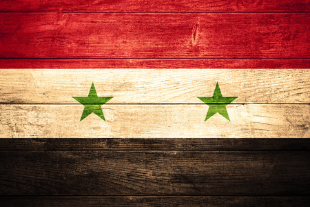 syrian: flag of Syria or  Syrian banner on wooden background Stock Photo