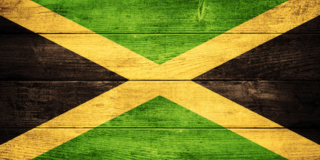 jamaica: flag of Jamaica or  Jamaican banner on wooden background