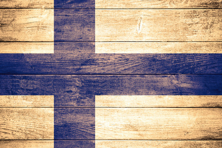 finnish: flag of Finland or Finnish banner on wooden background Stock Photo