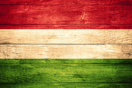 flag of Hungary or Hungarian banner on wooden background