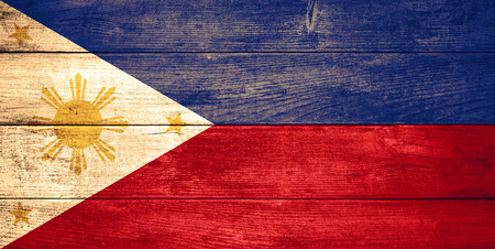 philippine: flag of the Philippines or Philippine  banner on wooden background