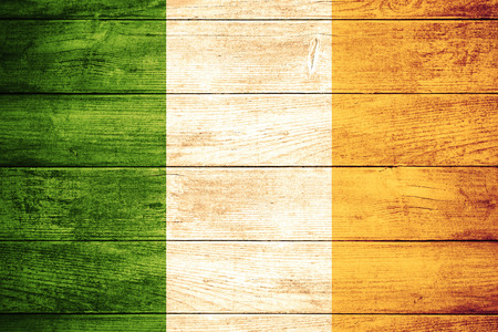 irish culture: flag of Ireland or Irish banner on wooden background Stock Photo