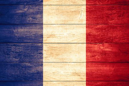 Flagge Frankreichs führen oder Französisch Banner auf Holzuntergrund