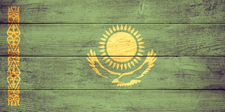 kazakh: flag of  Kazakhstan or  Kazakh banner on wooden background