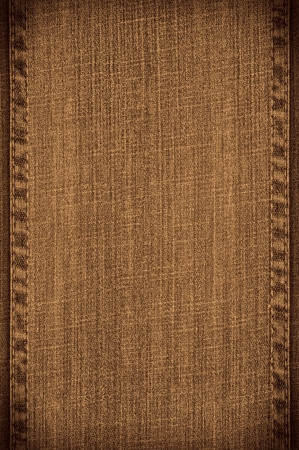 seams: brown jeans background or vanvas texture with seams