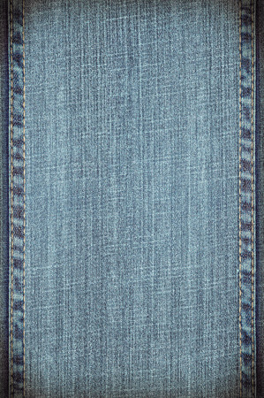seams: blue jeans background or vanvas texture with seams