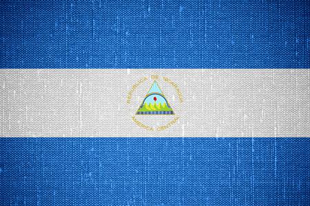 nicaraguan: flag of Nicaragua or Nicaraguan banner on canvas background Stock Photo