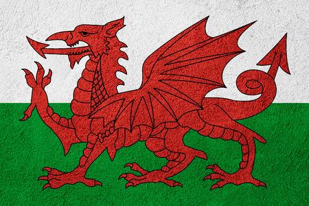 welsh flag: bandiera del Galles o gallese banner su sfondo di pietra Archivio Fotografico