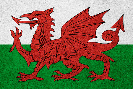 welsh flag: flag of Wales or Welsh banner on stone background Stock Photo