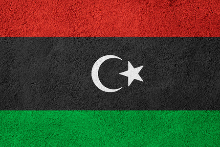libyan: flag of Libya or Libyan banner on rough pattern background