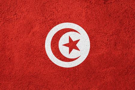 tunisian: flag of Tunisia or Tunisian banner on rough pattern background Stock Photo