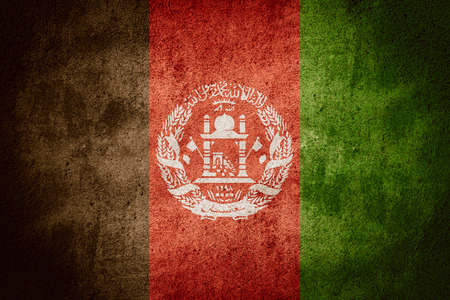 afghan: flag of Afghanistan or Afghan banner on rough pattern background