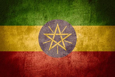 ethiopian: flag of Ethiopia or Ethiopian banner on rough pattern background Stock Photo