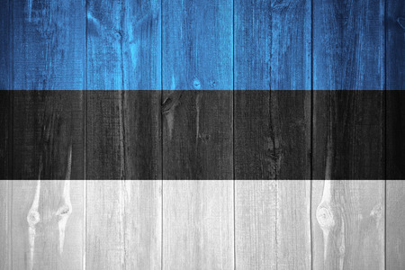 estonian: flag of Estonia or Estonian banner on wooden background