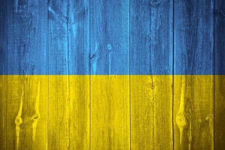 flag of Ukraine or Ukrainian banner on wooden background