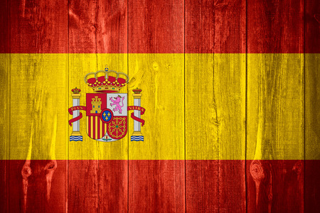 flag of Spain or Spainish banner on wooden background
