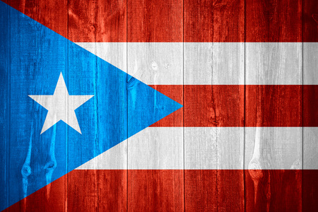 puerto rican: flag of Puerto Rico or Puerto Rican banner on wooden background Stock Photo