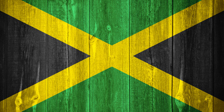 jamaican flag: flag of Jamaica or Jamaican banner on wooden background