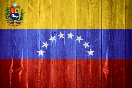 venezuelan: flag of Venezuela  or Venezuelan  banner on wooden background
