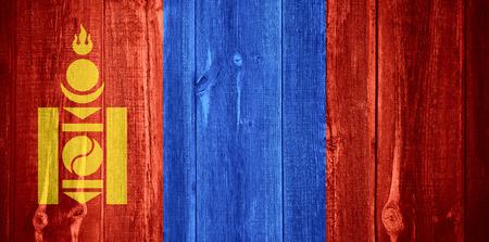 mongolian: flag of Mongolia or Mongolian banner on wooden background Stock Photo