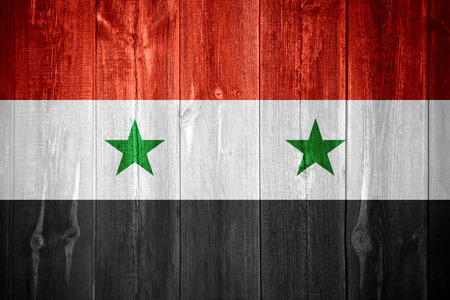 syrian: flag of Syria or Syrian banner on wooden background