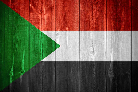 Sudan: flag of Sudan or Sudanese banner on wooden background