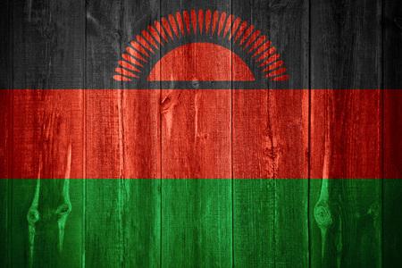 malawian: flag of Malawi or Malawian banner on wooden background