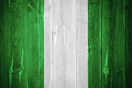 nigerian: flag of Nigeria or Nigerian banner on wooden background Stock Photo