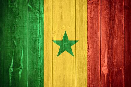 senegalese: flag of Senegal or Senegalese banner on wooden background