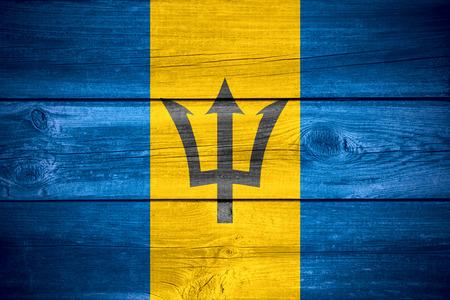 barbadian: flag of Barbados or Barbadian banner on wooden background
