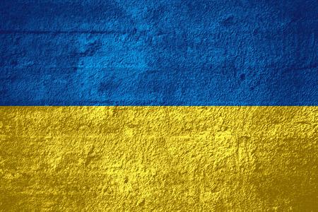 flag of Ukraine or Ukrainian banner on rough texture Фото со стока