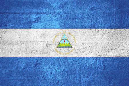 nicaraguan: flag of Nicaragua or Nicaraguan banner on rough texture