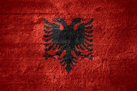 albanian: flag of Albania or Albanian banner on rough texture Stock Photo