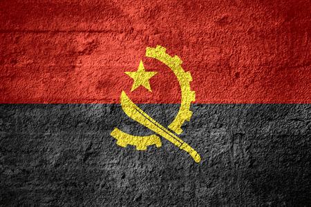angola: flag of Angola or Angolan banner on rough texture Stock Photo