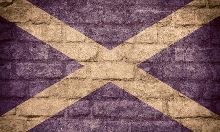 scottish flag: bandiera della Scozia o un banner scozzese sulla trama del mattone