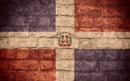 dominican: flag of Dominican Republic or Dominican banner on brick texture
