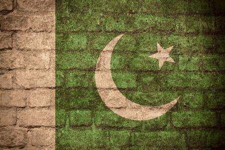 pakistani pakistan: flag of Pakistan or Pakistani banner on brick texture Stock Photo