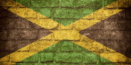 jamaican: flag of Jamaica or Jamaican banner on brick texture Stock Photo