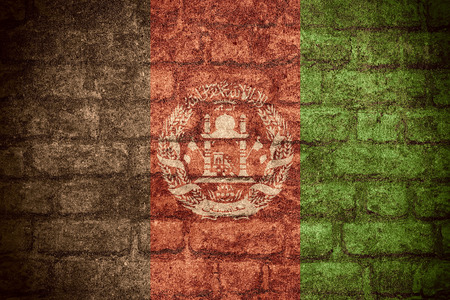 afghan flag: flag of Afghanistan or Afghan banner on brick texture Stock Photo