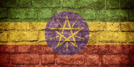 ethiopian: flag of Ethiopia or Ethiopian banner on brick texture