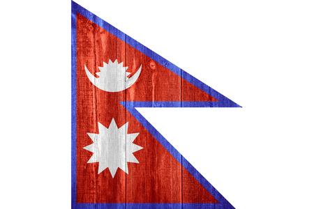 nepali: flag of Nepal or Nepali banner on wooden background Stock Photo