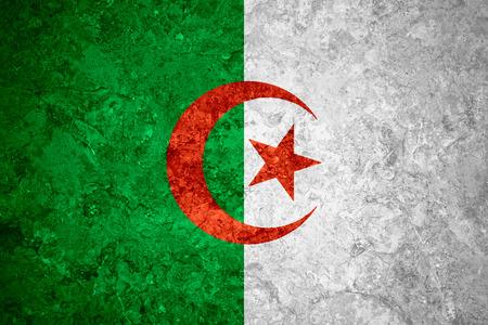 algerian flag: flag of Algeria or Algerian banner on vintage background Stock Photo