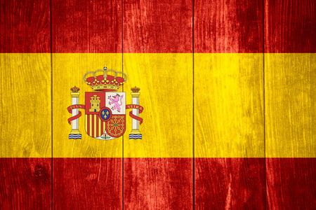 spainish: flag of Spain or Spainish banner on wooden background